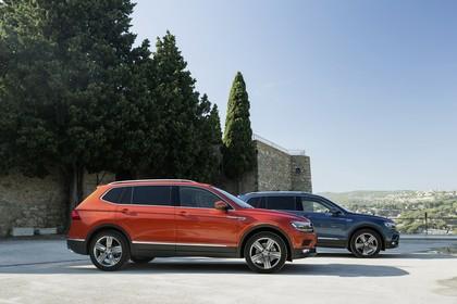 VW Tiguan Allspace AD Aussenansicht Seite statisch orange blau