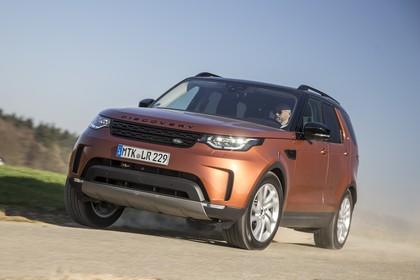 Land Rover Discovery LR Aussenansicht Front schräg dynamisch orange