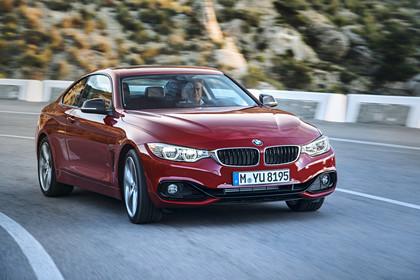 BMW 4er Coupe F32 Aussenansicht Front schräg dynamisch rot