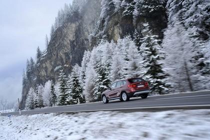 BMW X1 E84 Aussenansicht Heck schräg dynamisch rot